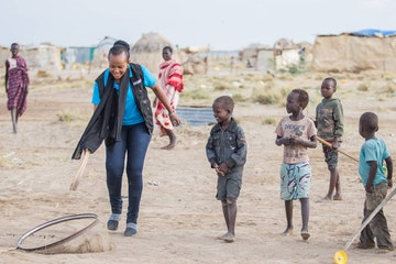 Jesca Edung Lomongin playing with children in Turkana, Kenya