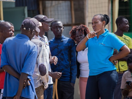Jesca Edung Lomongin talking to a boda boda (motorbike taxi) group