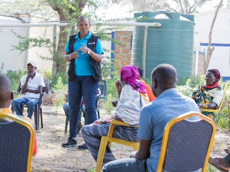Jesca Edung Lomongin giving a training to the local Child Protection Committee in Lokichar, Kenya