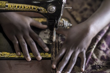 Tanzanian girl sewing
