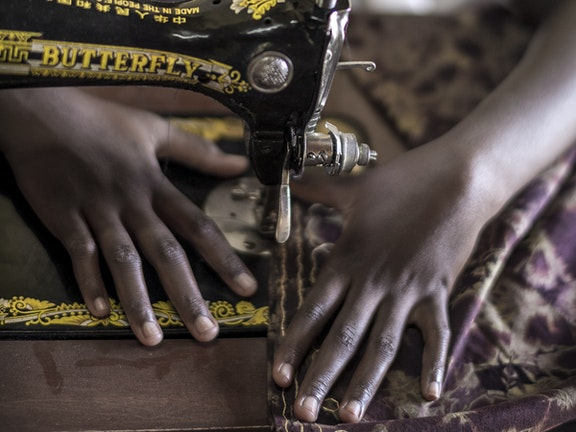Tanzanian girl sewing