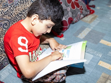 Louay studying at home
