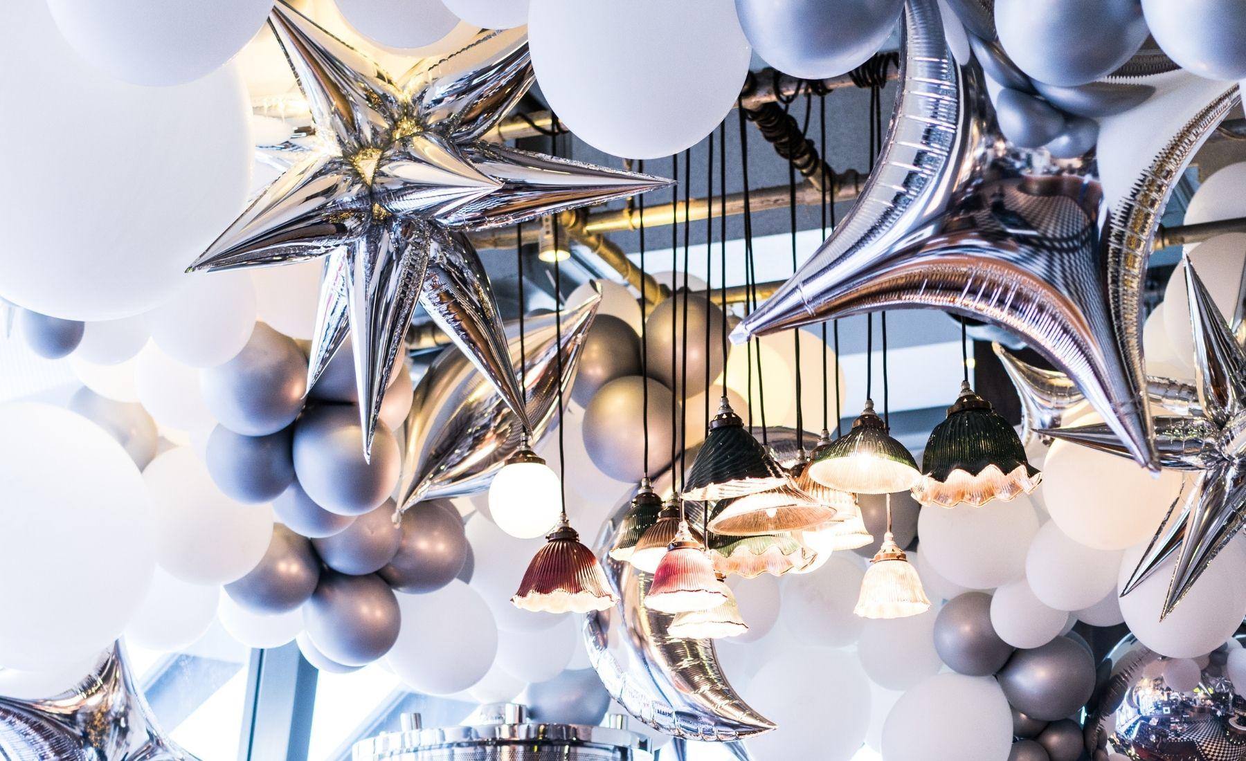 metallic orbs, star and moon balloons installation