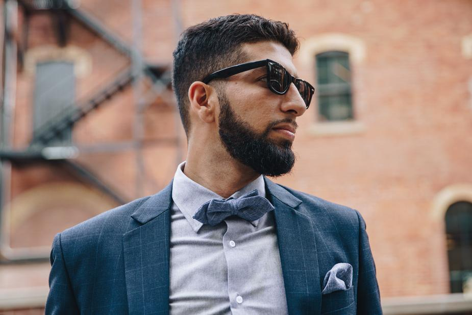 man dressed in bowtie and sunglasses