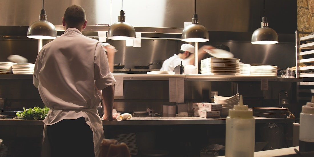 chefs and waiters working in a restaurant