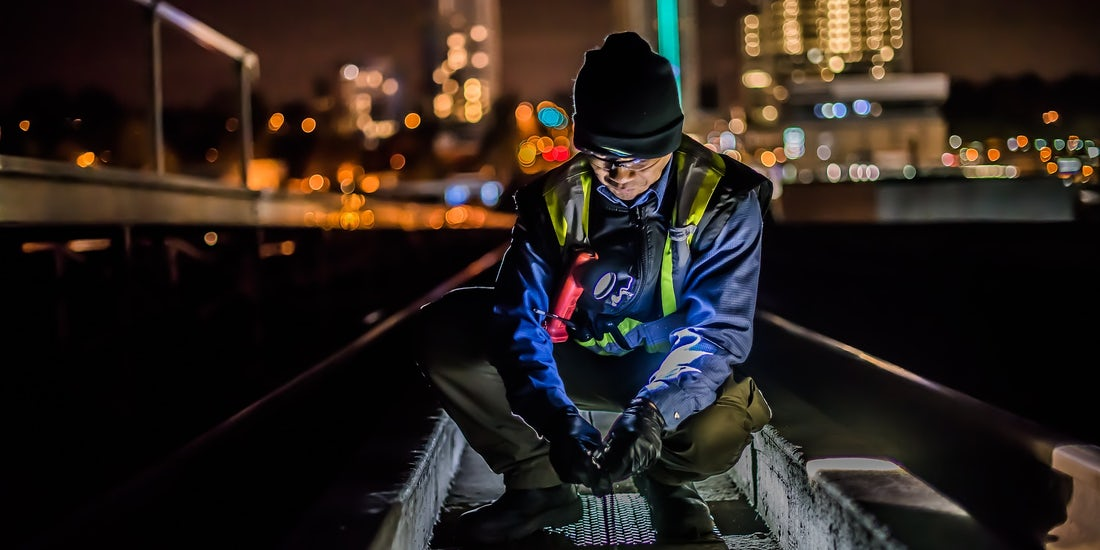 male working in city at night