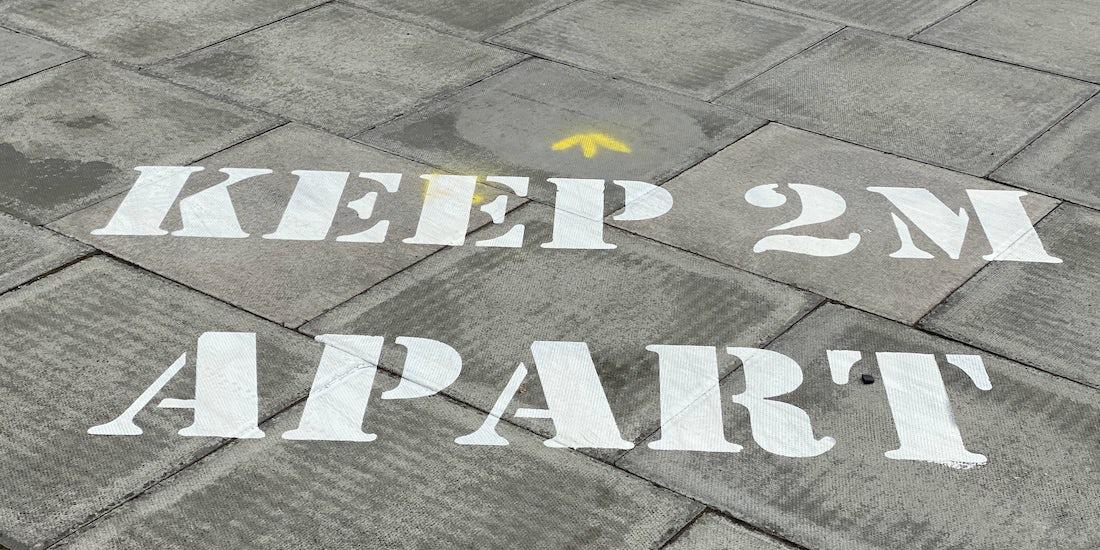 Keep 2m apart written on path