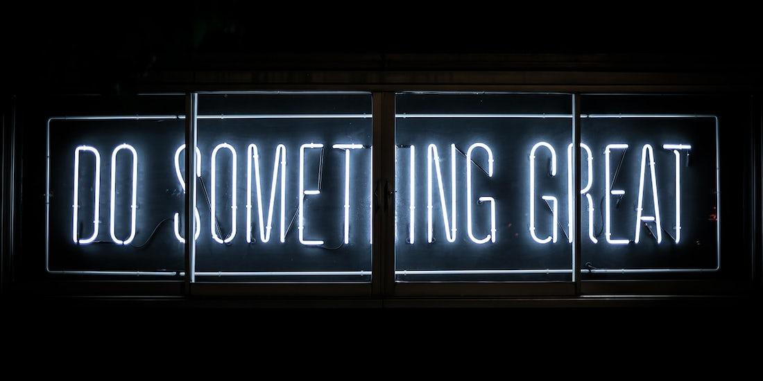 illuminated 'do something great' sign