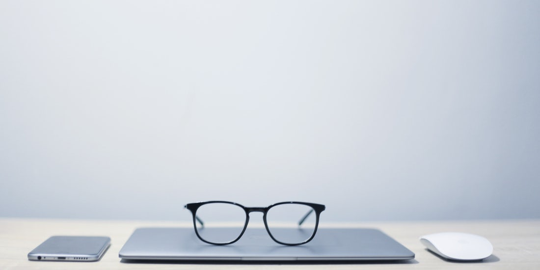 Glasses on top of laptop