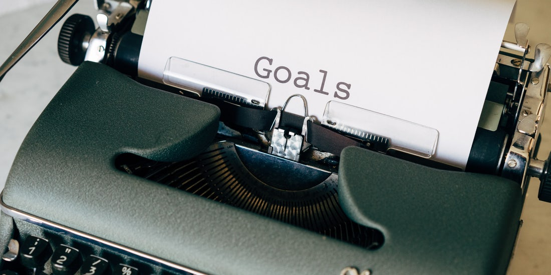 Typewriter with 'goals' typed on a piece of paper