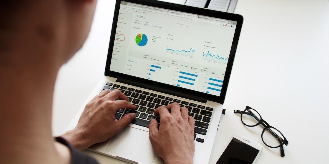 Man using a spreadsheet on a laptop