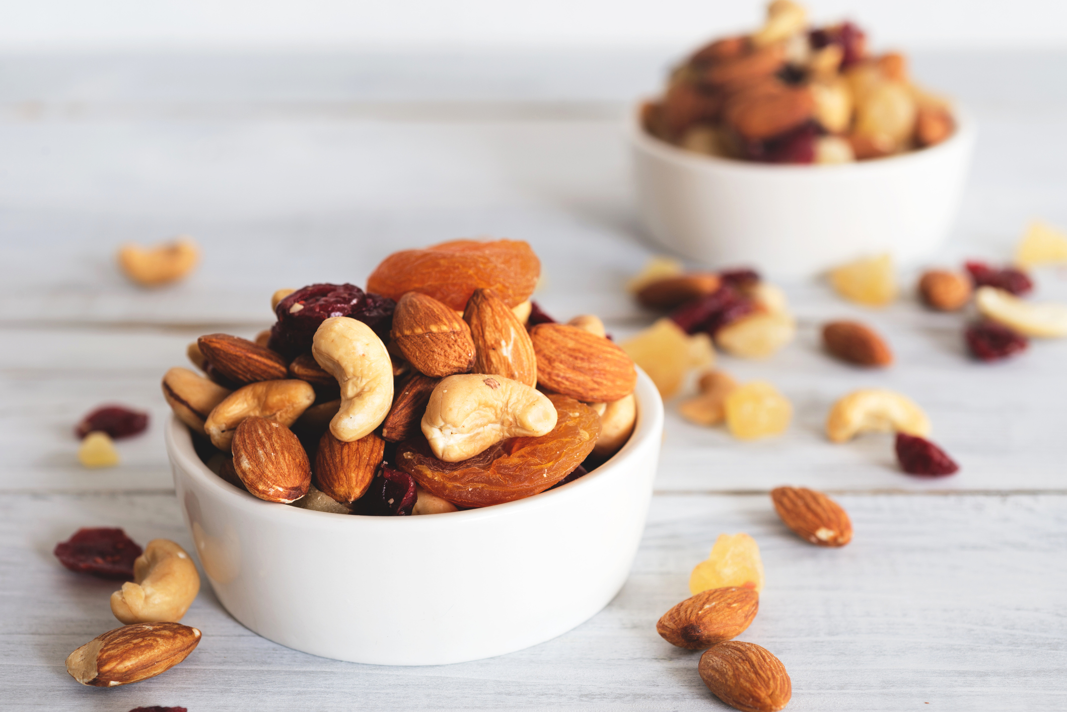 Small bowls of nuts and dried fruits
