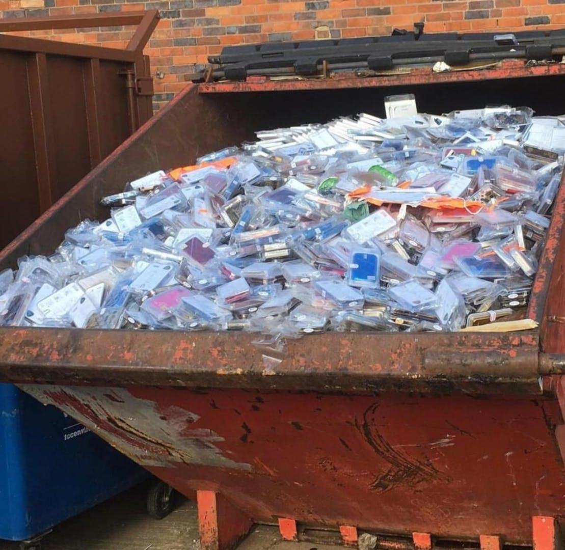 Dumpster full of plastic phone cases