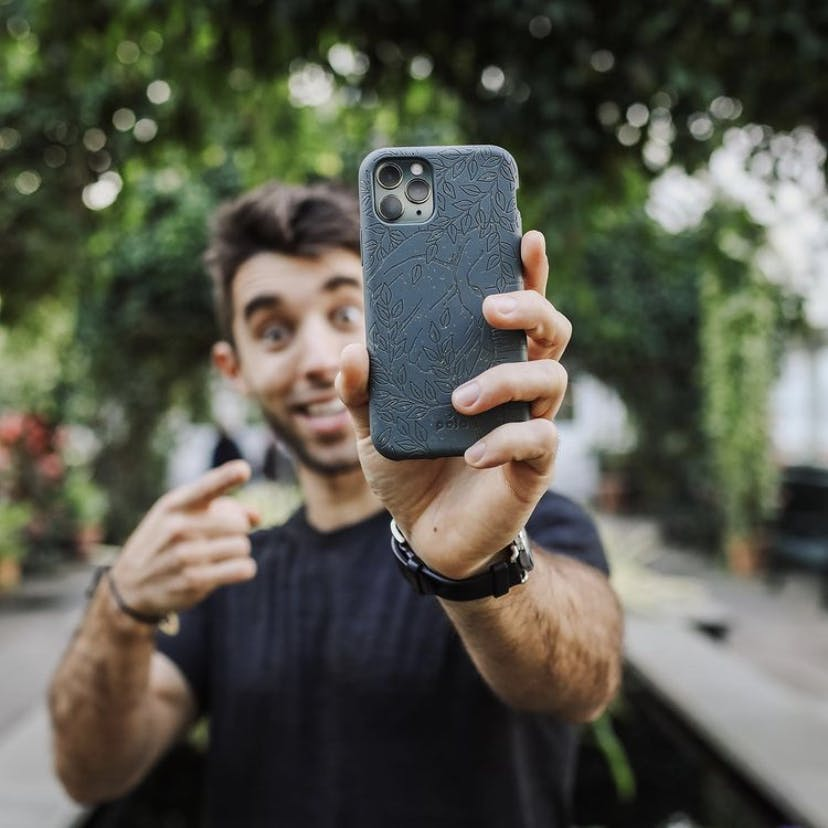Man with biodegradable eco-friendly Pela phone case