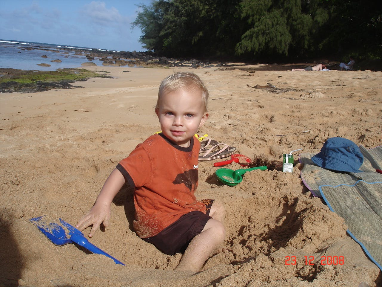 Cole digging up plastic in Hawaii