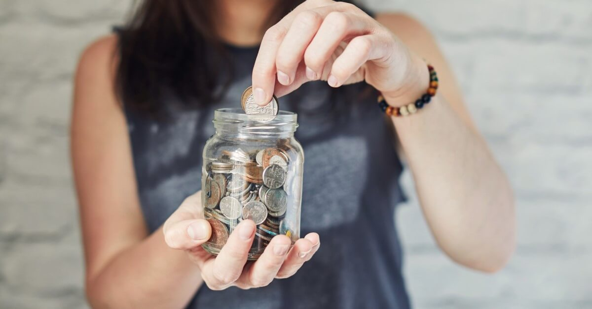 Woman Holding Spare Change Jar