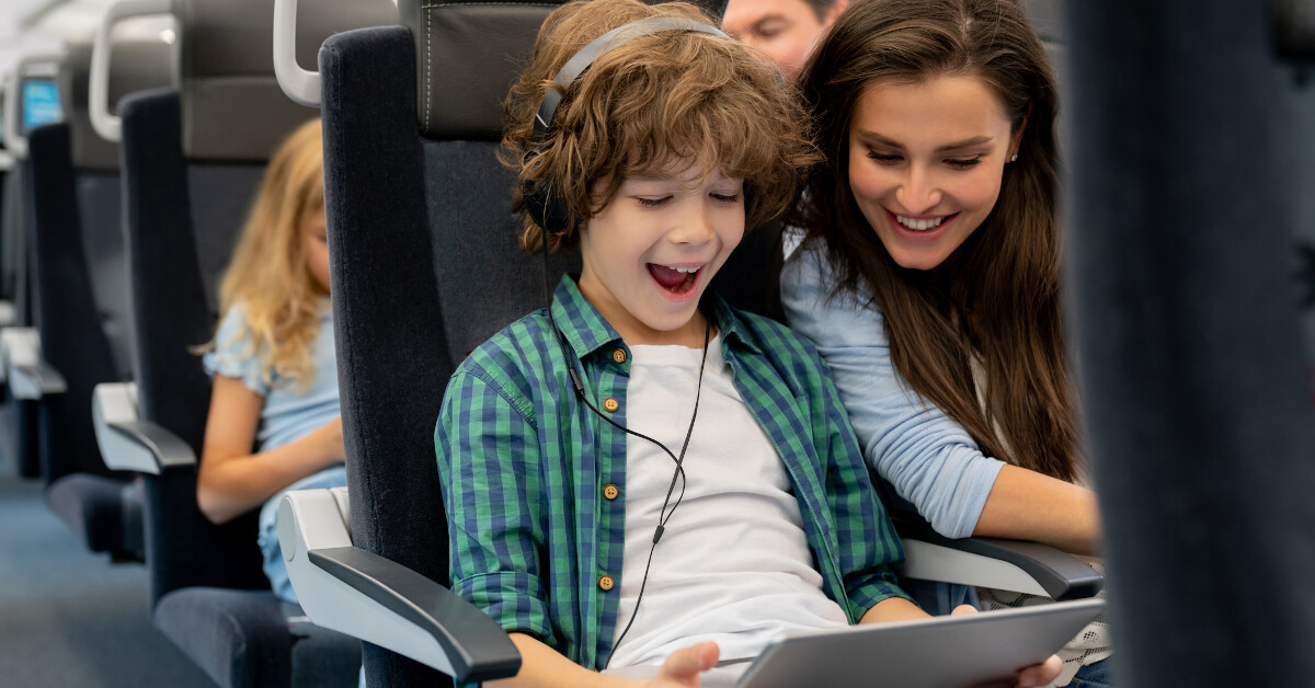 Kid Wearing Headphones and Using a Tablet