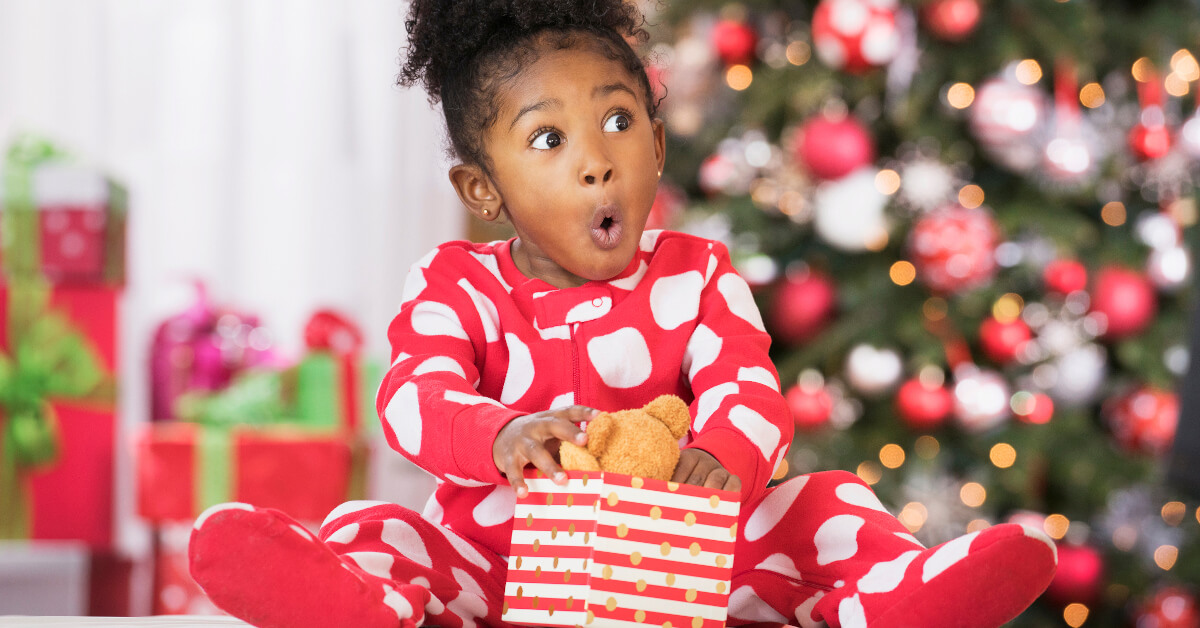 Little Girl Opening Holiday Present