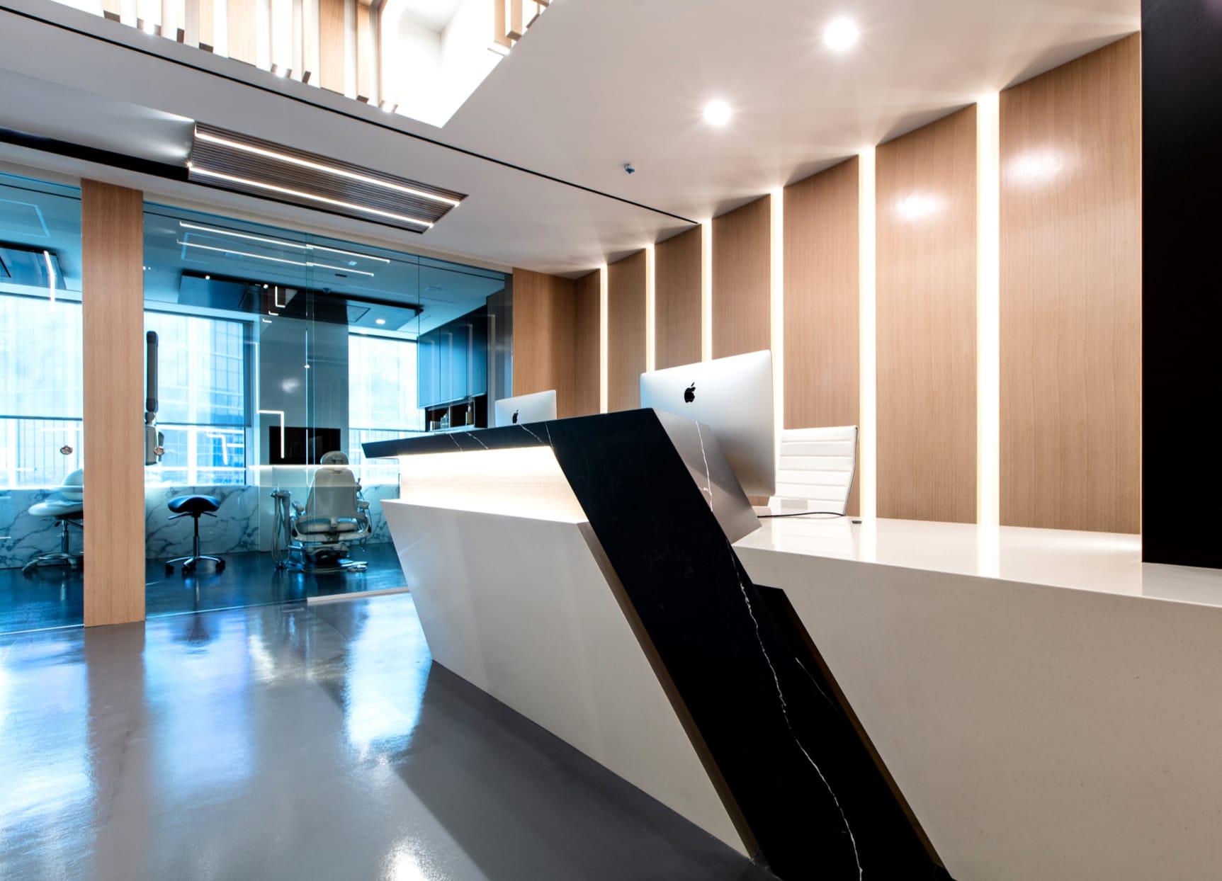 Receptionist desk - clean, modern, sleek lines.