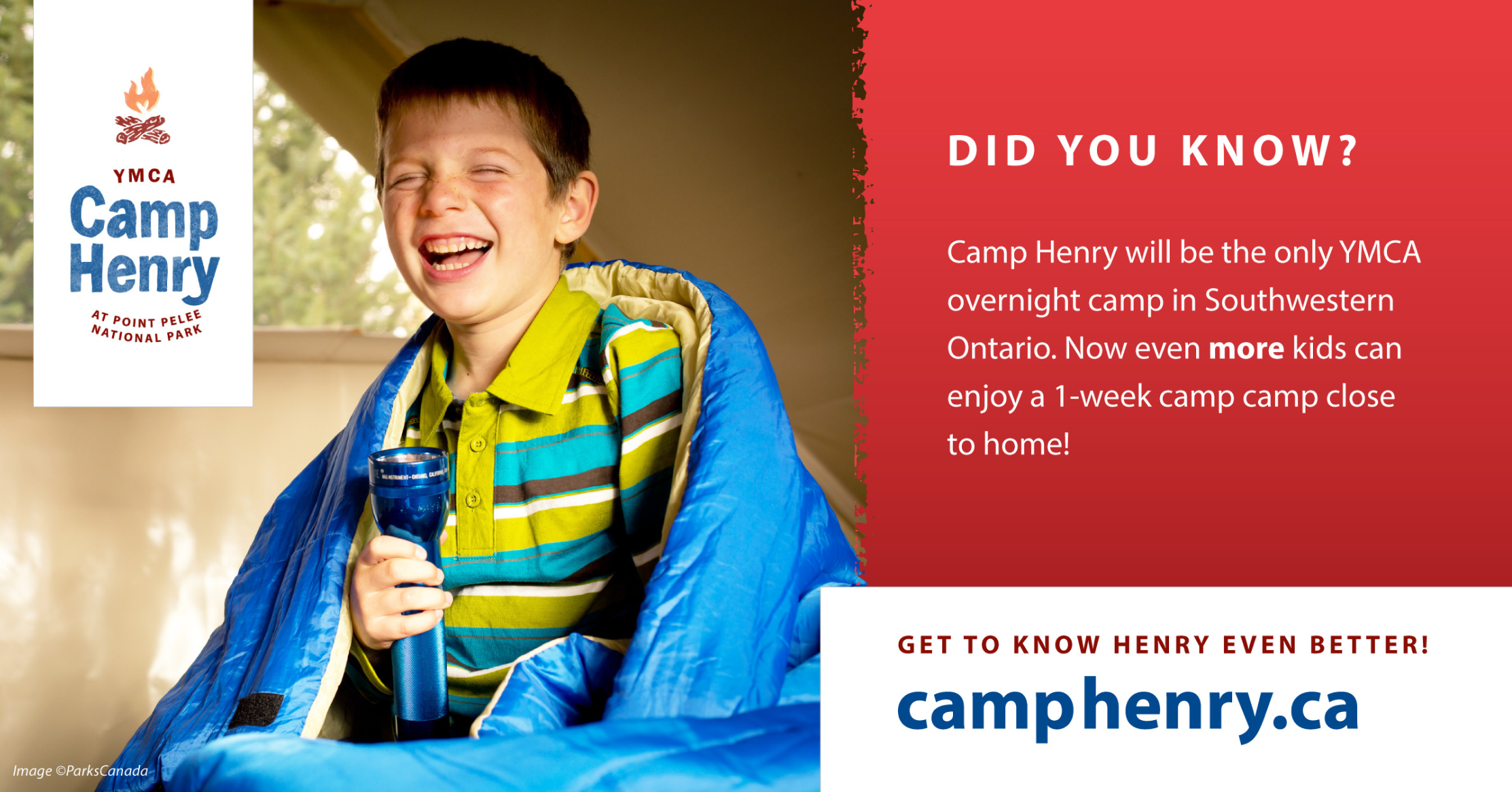 Camp Henry postcard showing a laughing boy in his tent