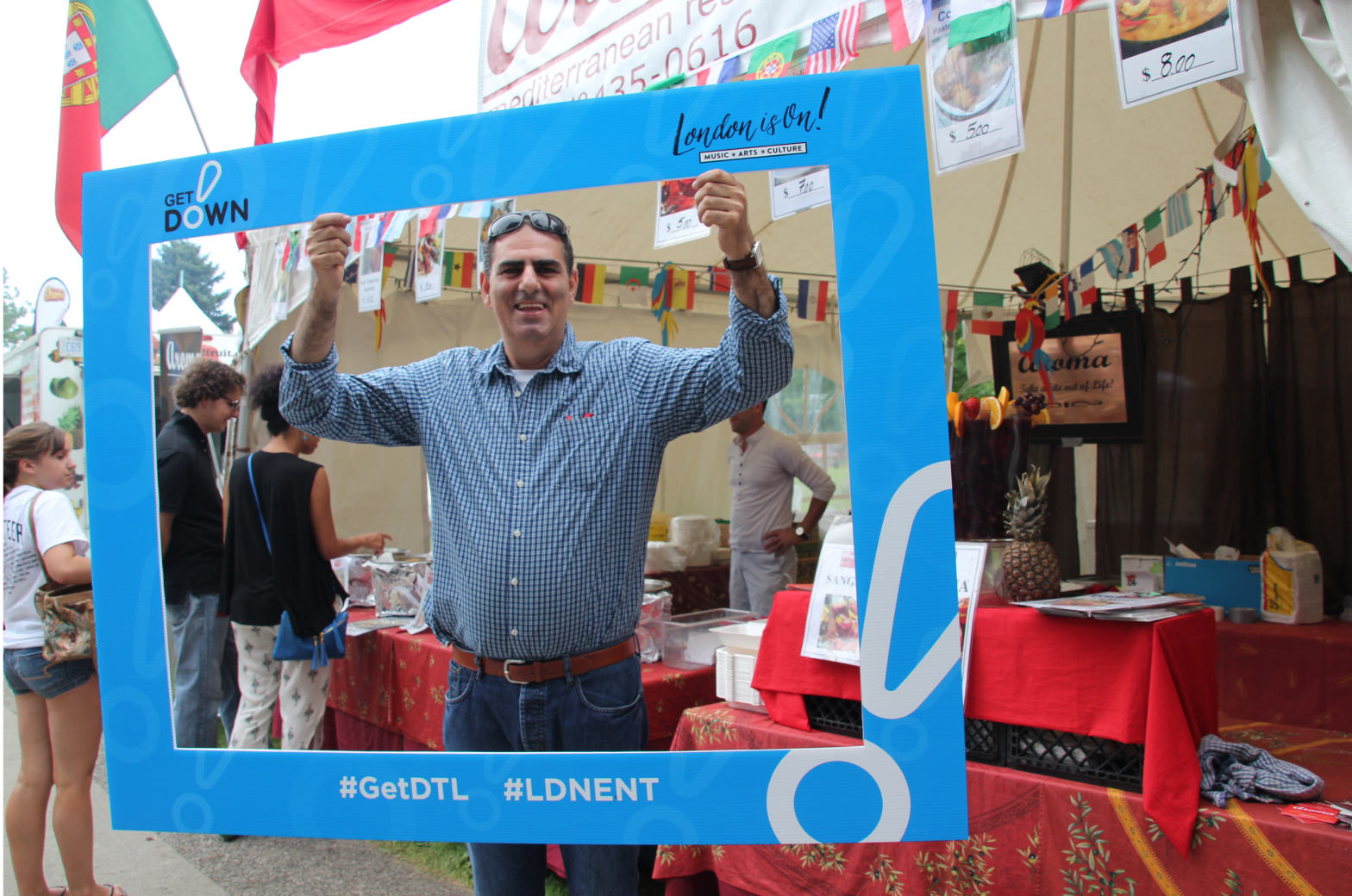 Man posing with the #GetDTL photo frame