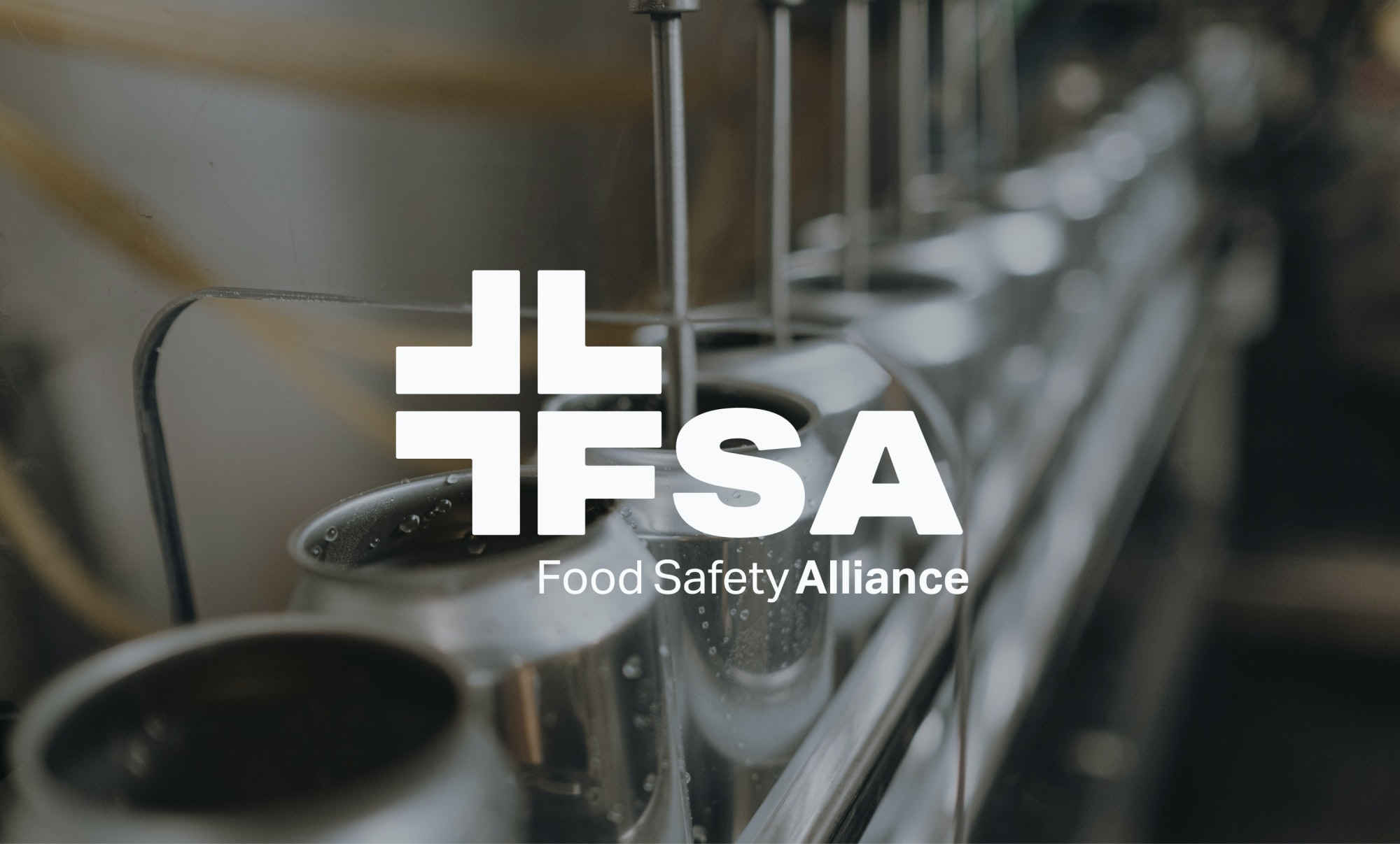 FSA Logo overlaid on image of cans on production line