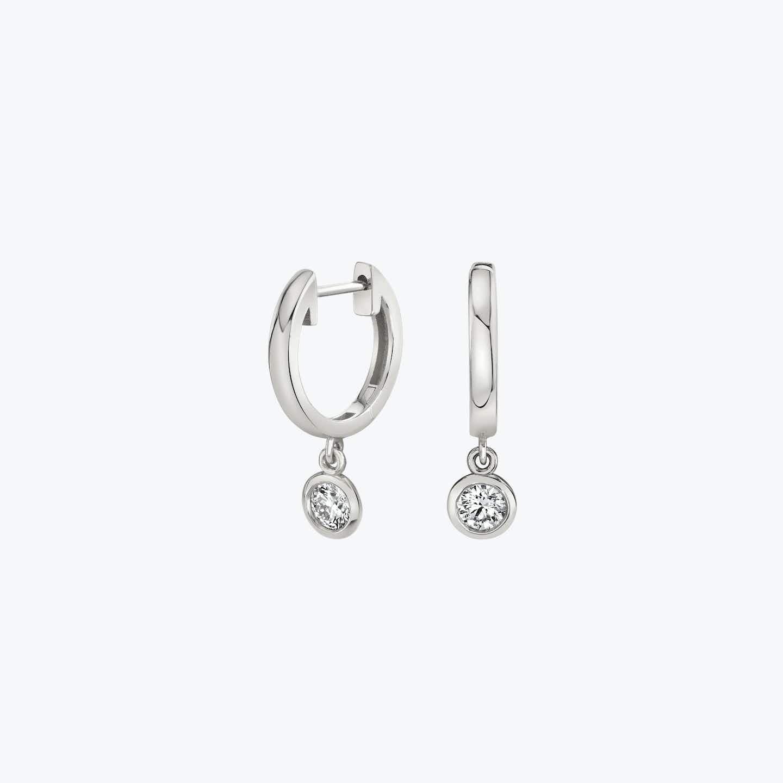 Closeup image of Diamond Bezel Drop Huggie Hoops