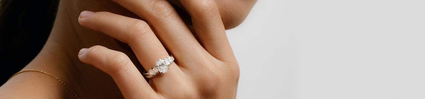 Oval Three Stone Engagement Ring with Pear sides