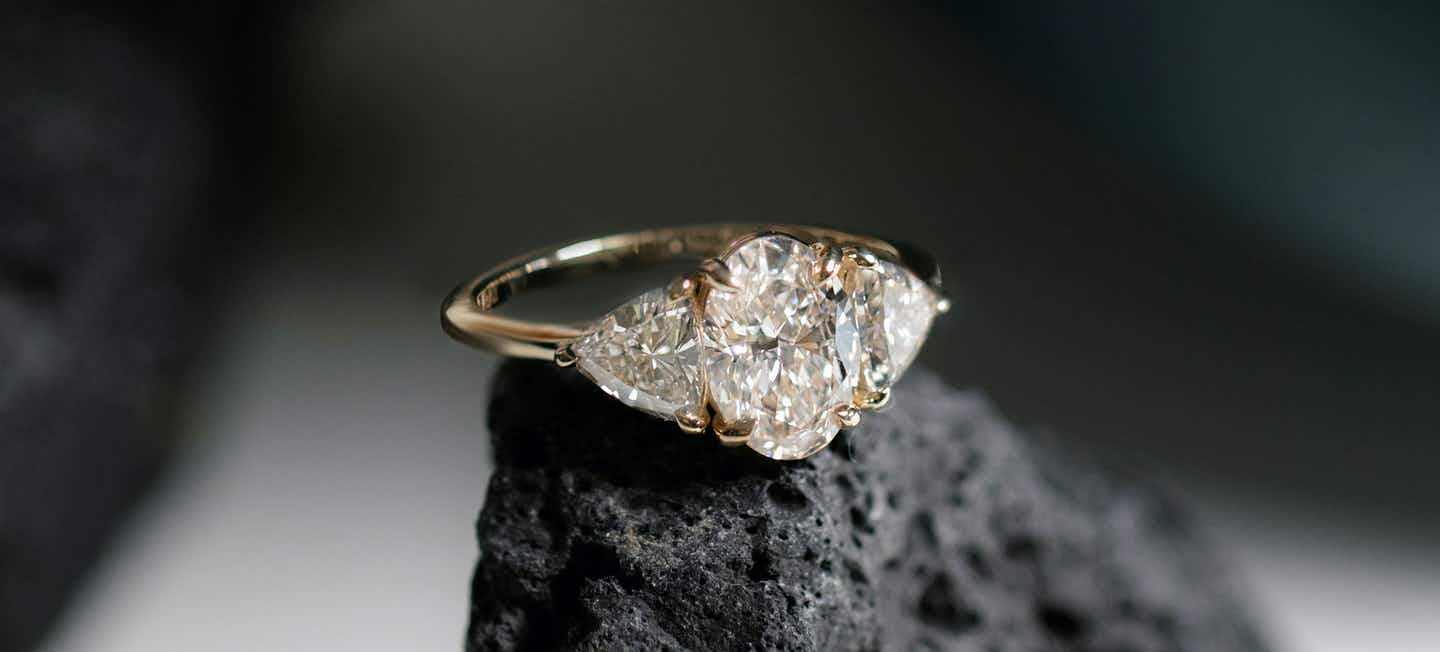 Oval Three Stone Engagement Ring with Trillion side stones