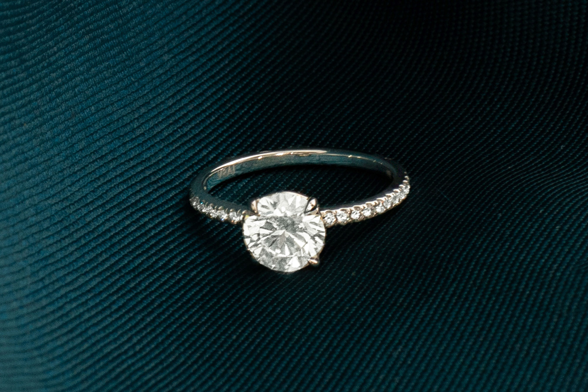 The round brilliant signature engagement ring with pave band
