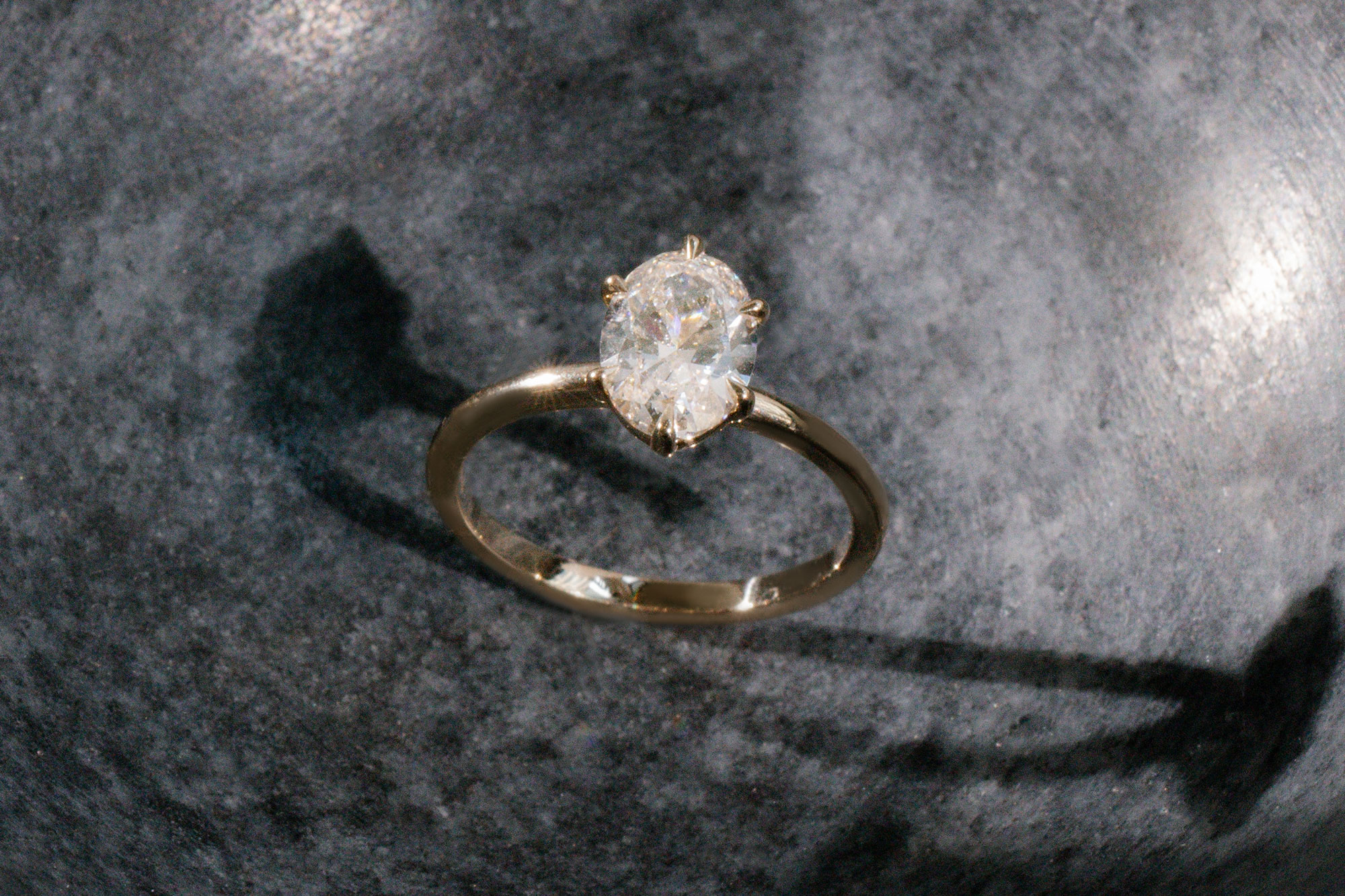 The oval signature 6 prong with yellow gold band