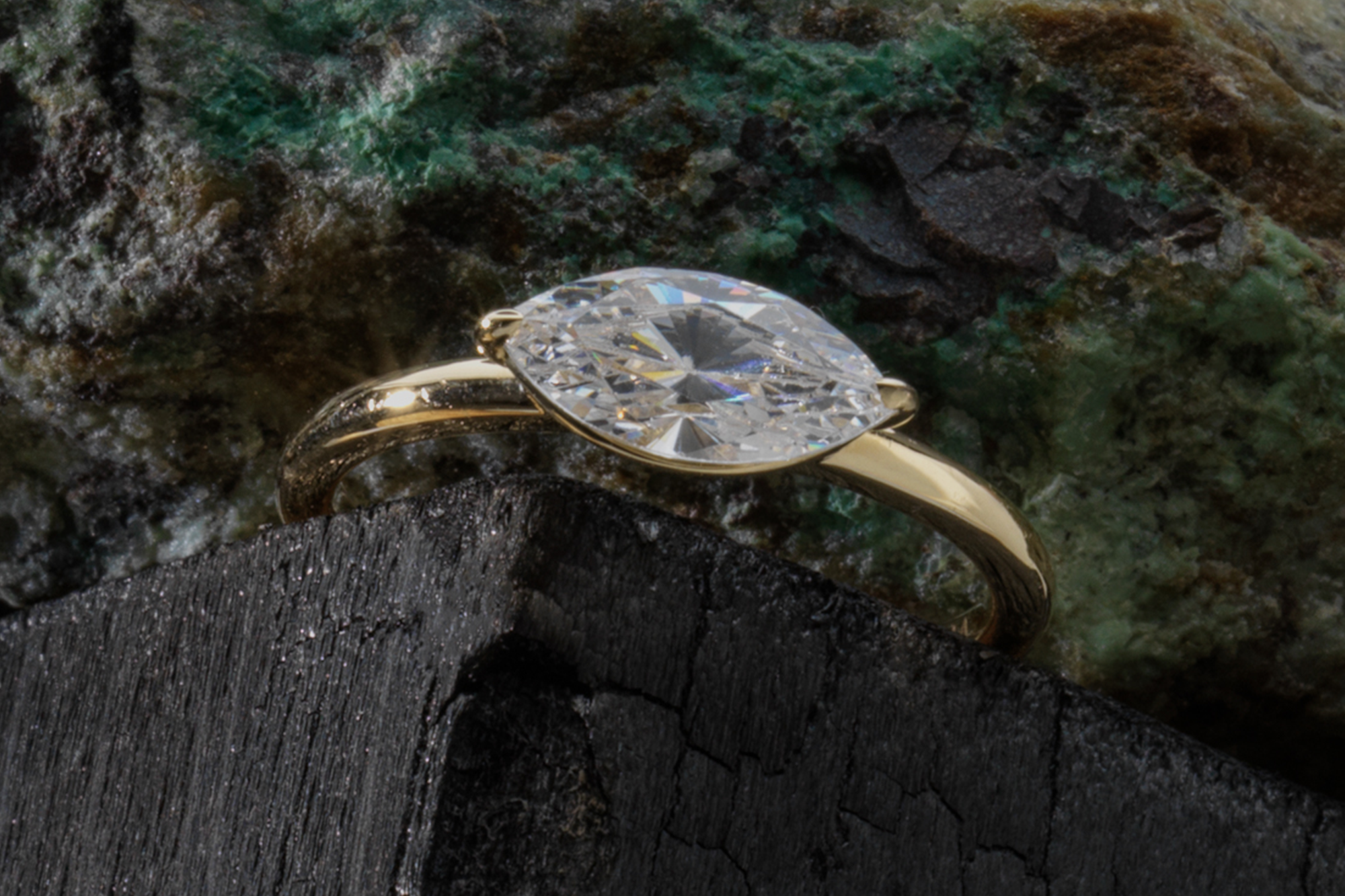 The marquise signature east west engagement ring with yellow gold band
