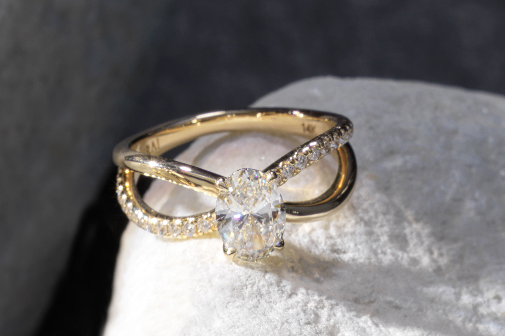 The oval duet engagement ring with yellow gold pave band