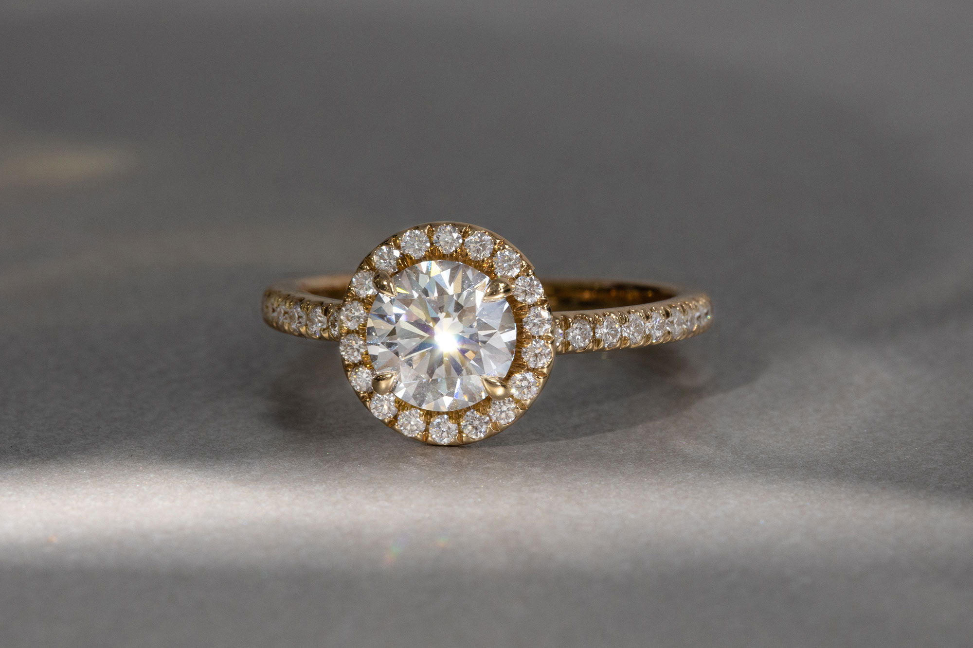 the round brilliant halo engagement ring with yellow gold pave band