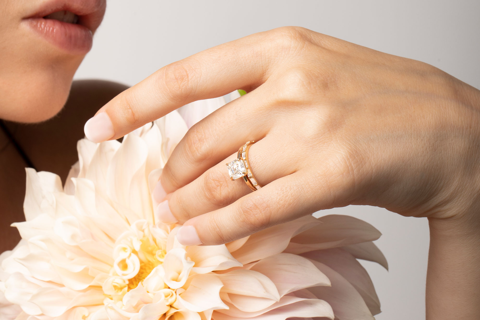 The signature asscher engagement ring with yellow gold band