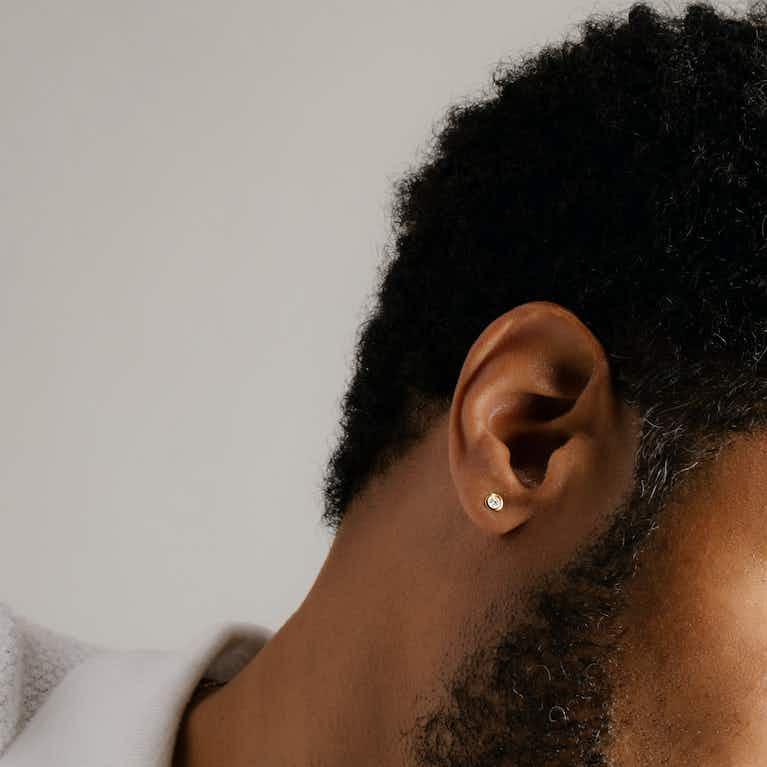 Closeup image of VRAI Bezel Earring