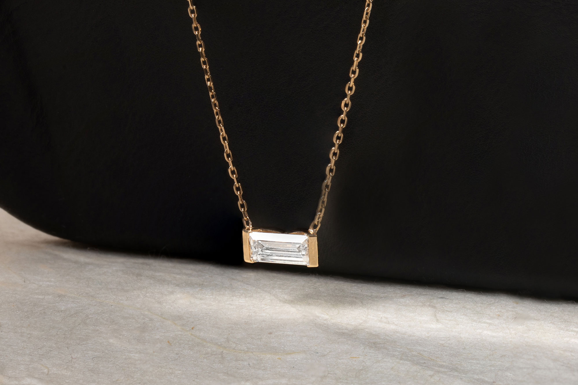 Yellow gold baguette semi-bezel necklace
