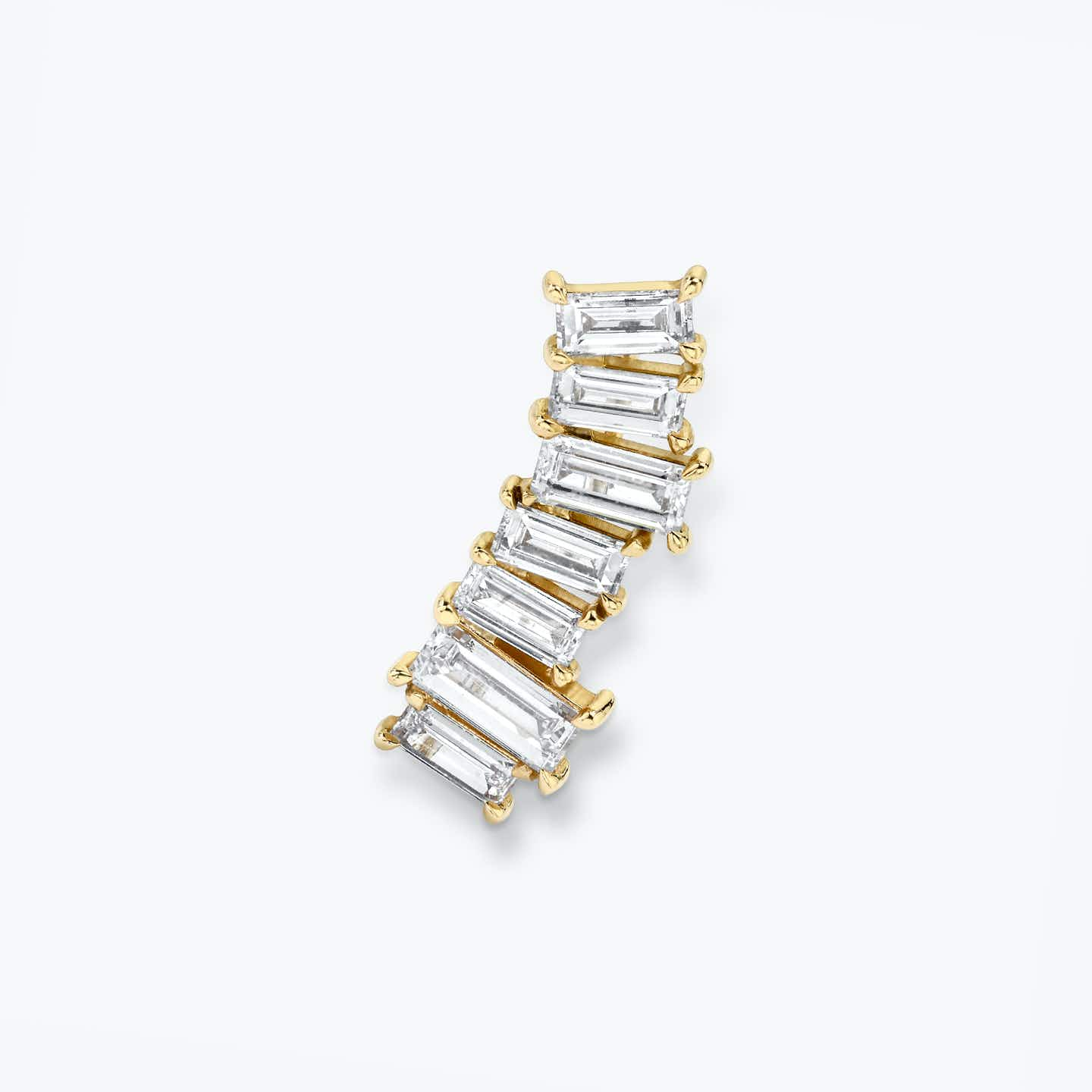Ear arc made out of solid yellow gold and 7 baguette shaped diamonds