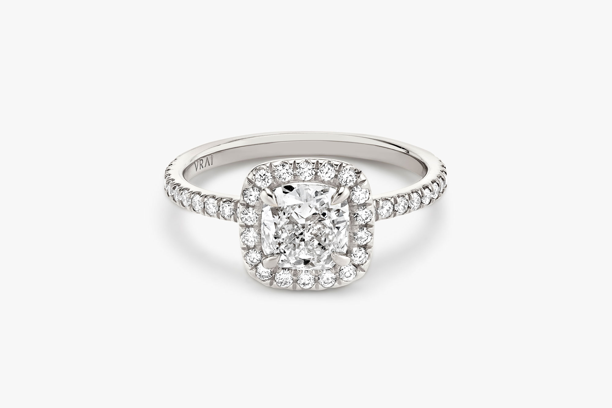 halo ring in platinum with cushion cut diamond and pave band