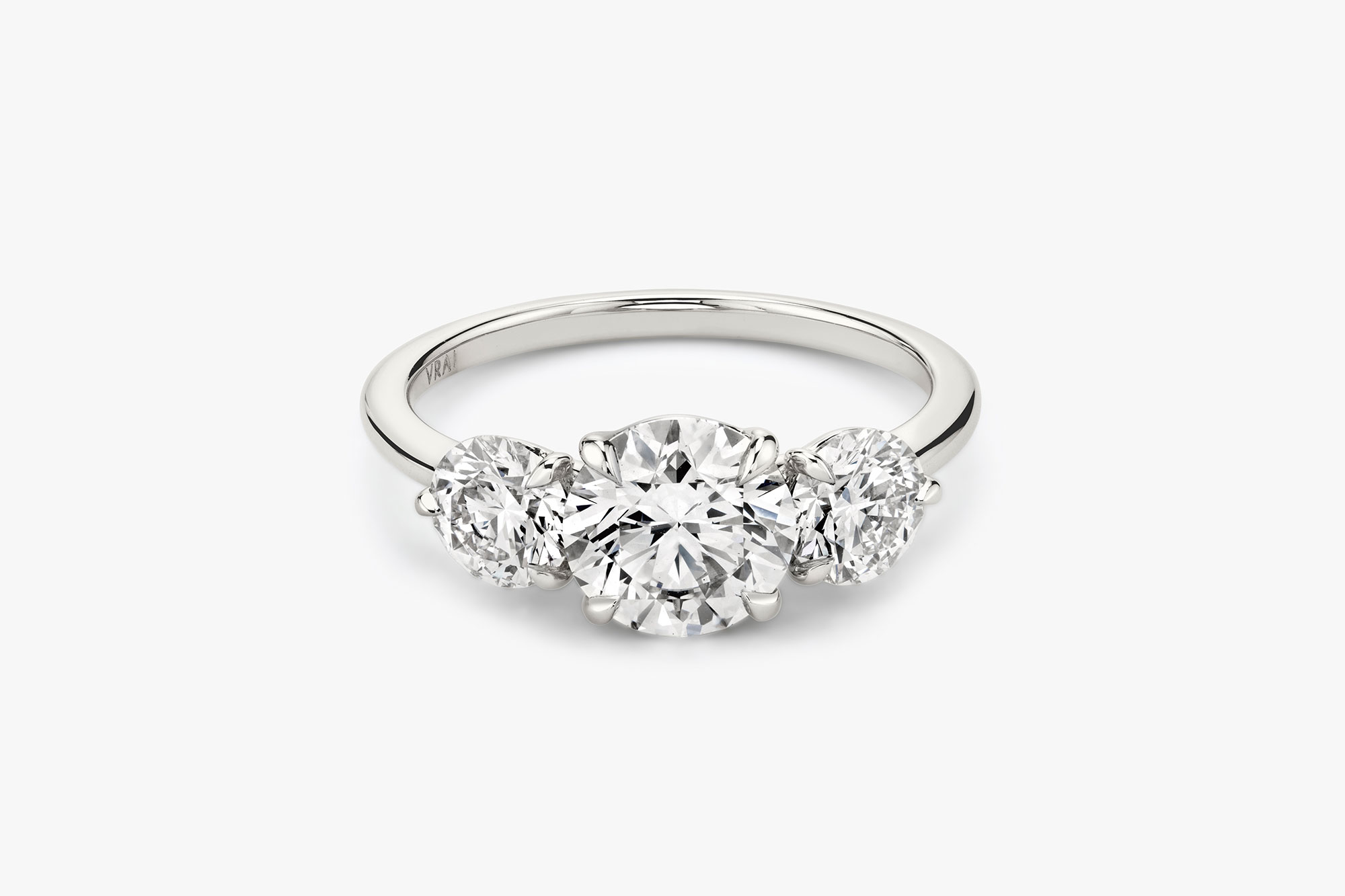 The Three Stone ring in platinum with a round brilliant cut diamond