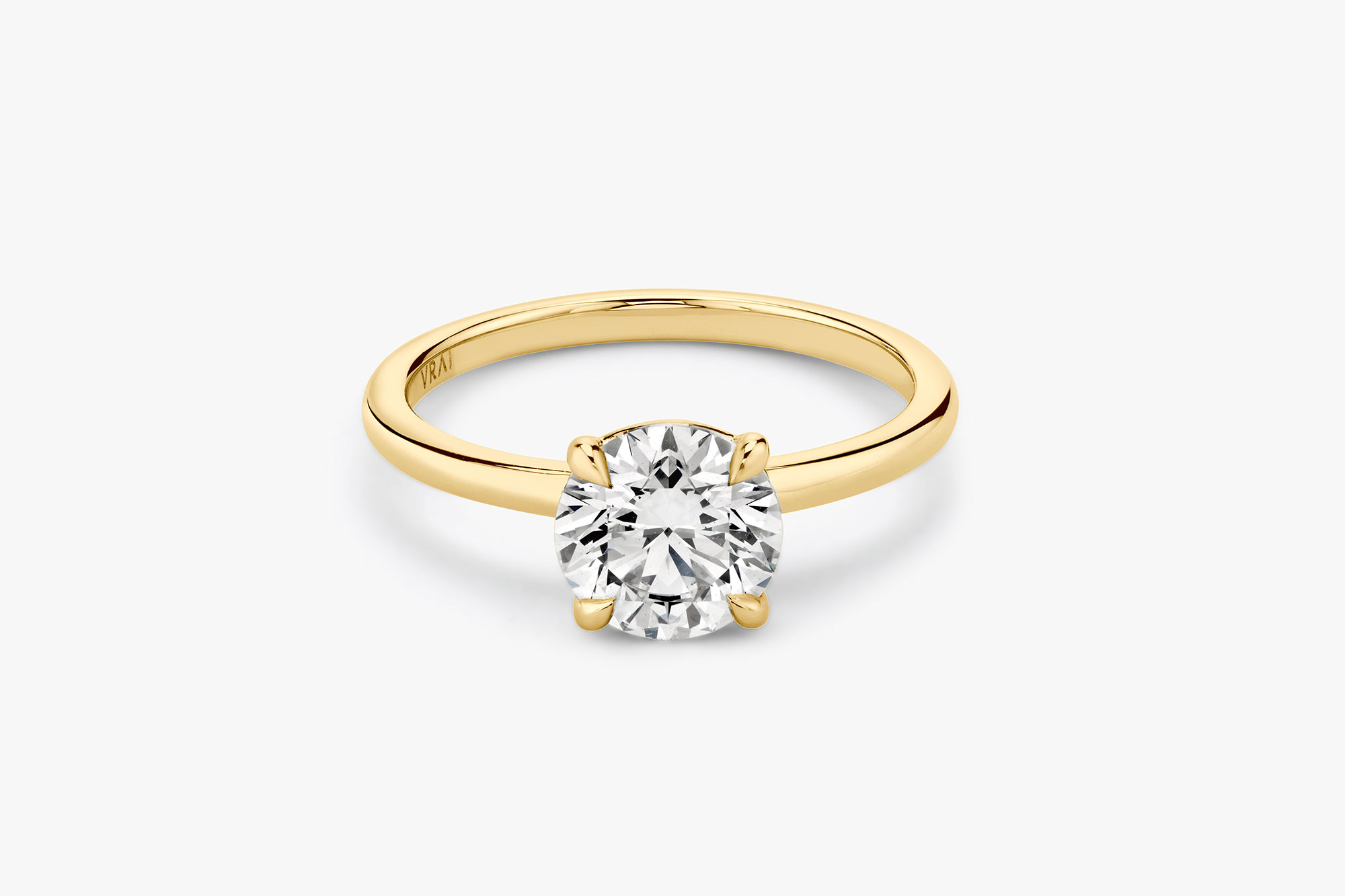 The Signature solitaire ring in 18k yellow gold with a round brilliant cut diamond