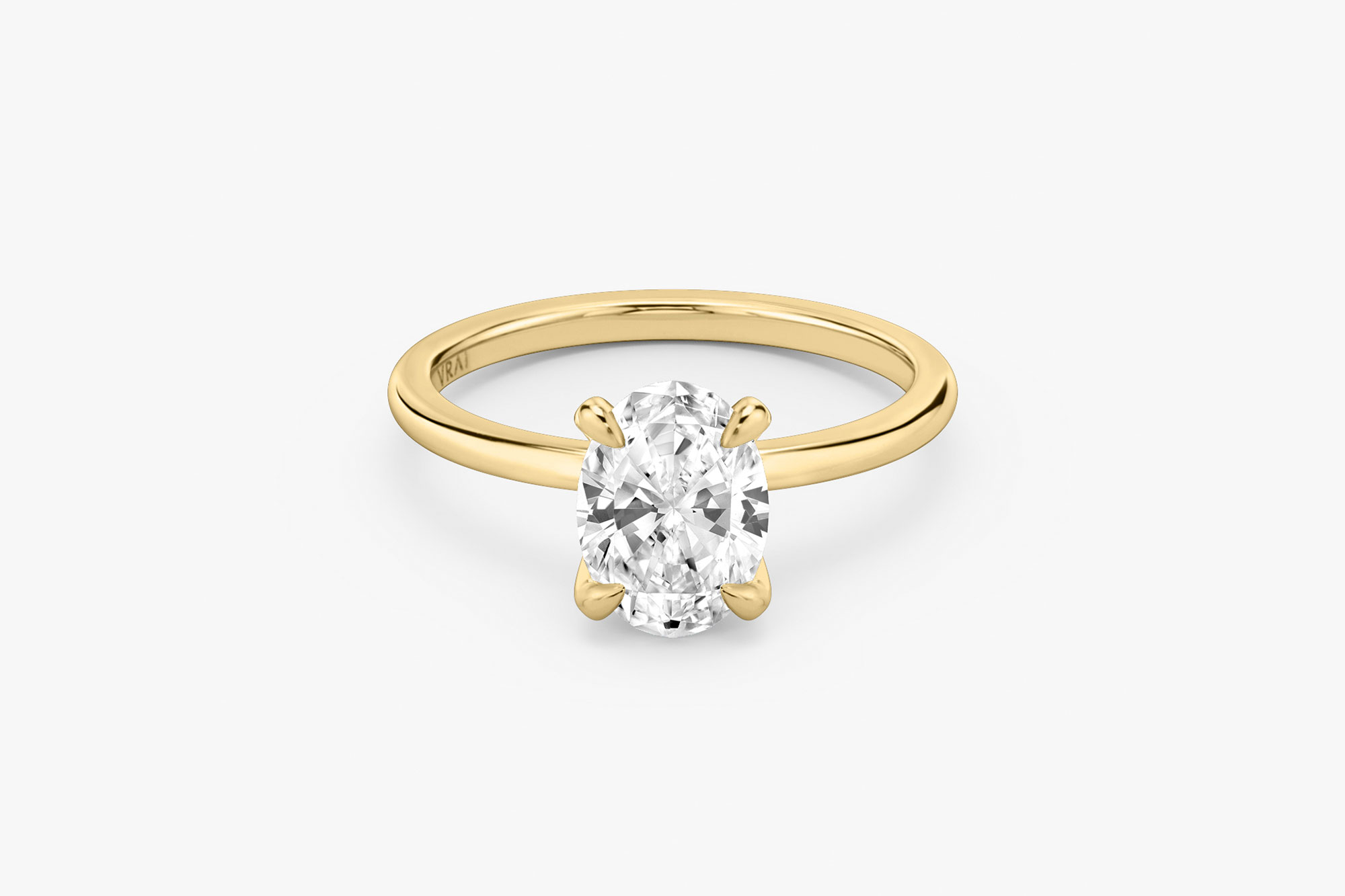 The Classic solitaire in 18k yellow gold with an oval cut diamond
