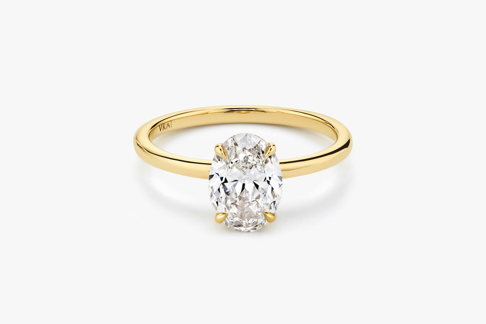 The Signature solitaire ring in 18k yellow gold with an oval cut diamond