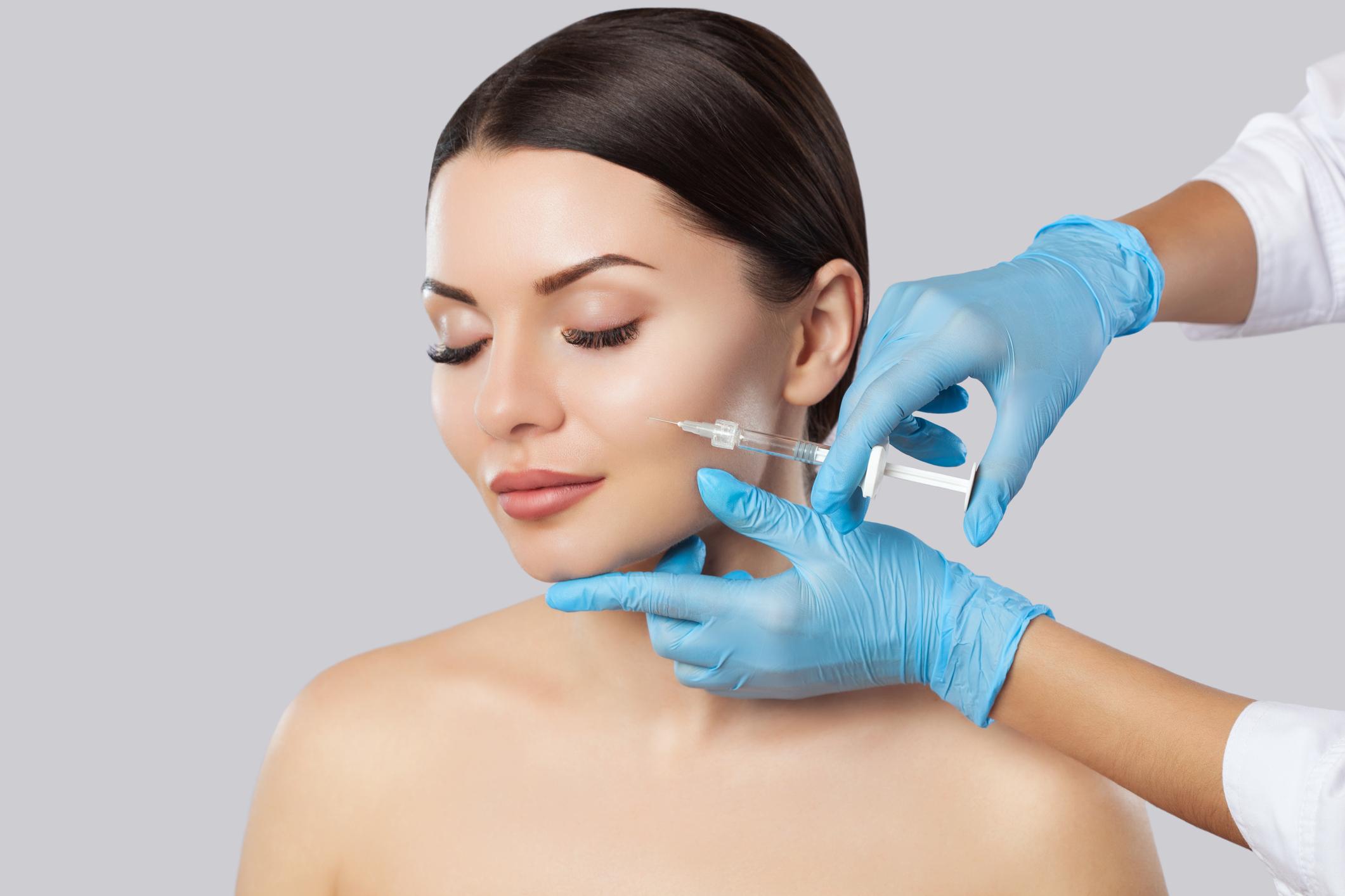 Model receiving botox injections