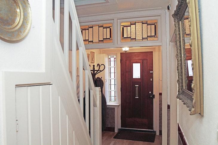 [wood banister handrail door hardwood flooring indoors interior design staircase]