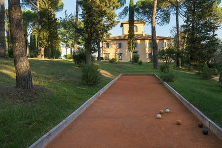 A pristine red clay court for bowls near Villa La Tavernaccia