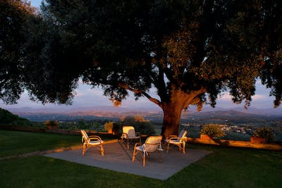 The private garden of Villa La Tavernaccia has a unique vista on the rolling hills of Chianti.