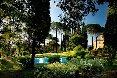 The heated swimming pool in Villa La Tavernaccia is surrounded by a private garden