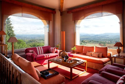 The living room in the tower of Villa Tavernaccia offers a 360-degree view of Florence and the Chianti Hills.