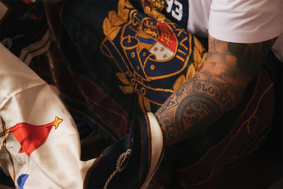 Close up of a tattooed arm and fabric.